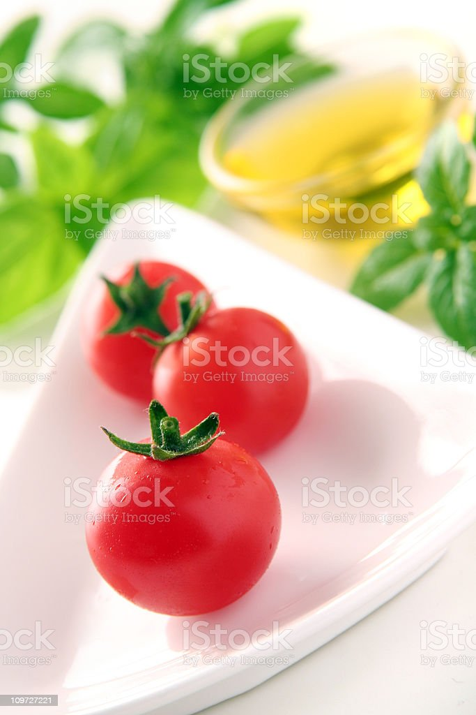 Tomatoes and Basil with Olive Oil royalty-free stock photo