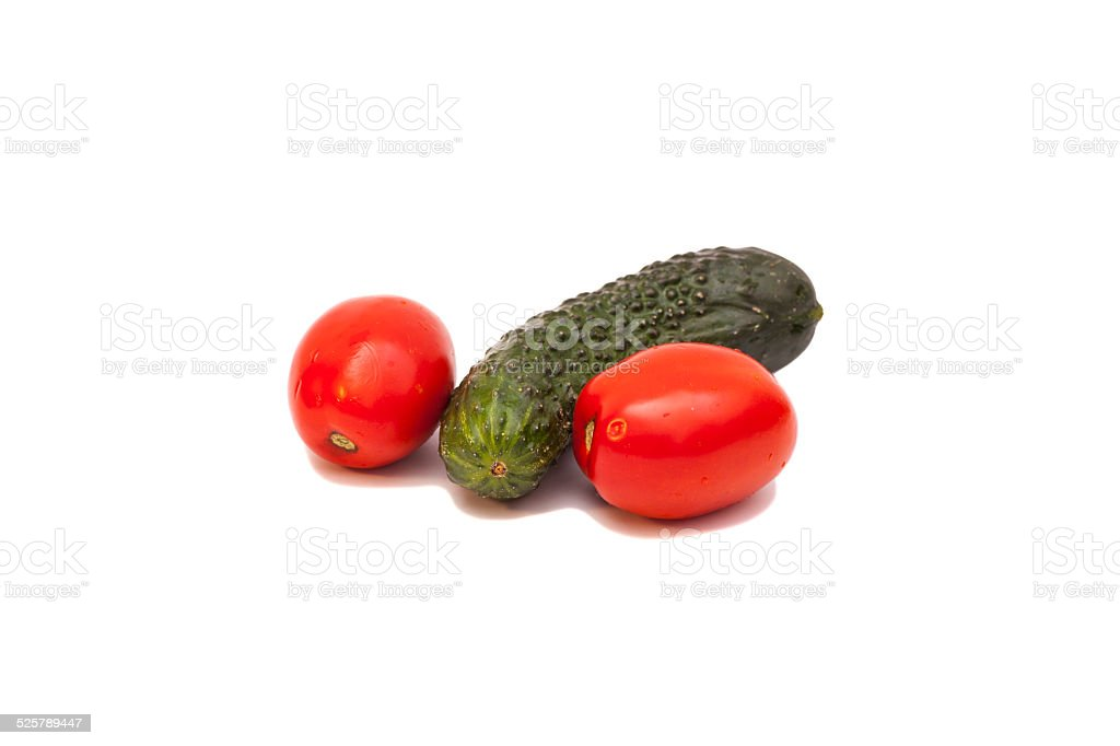 Tomatoes and cucumber  isolated on white stock photo