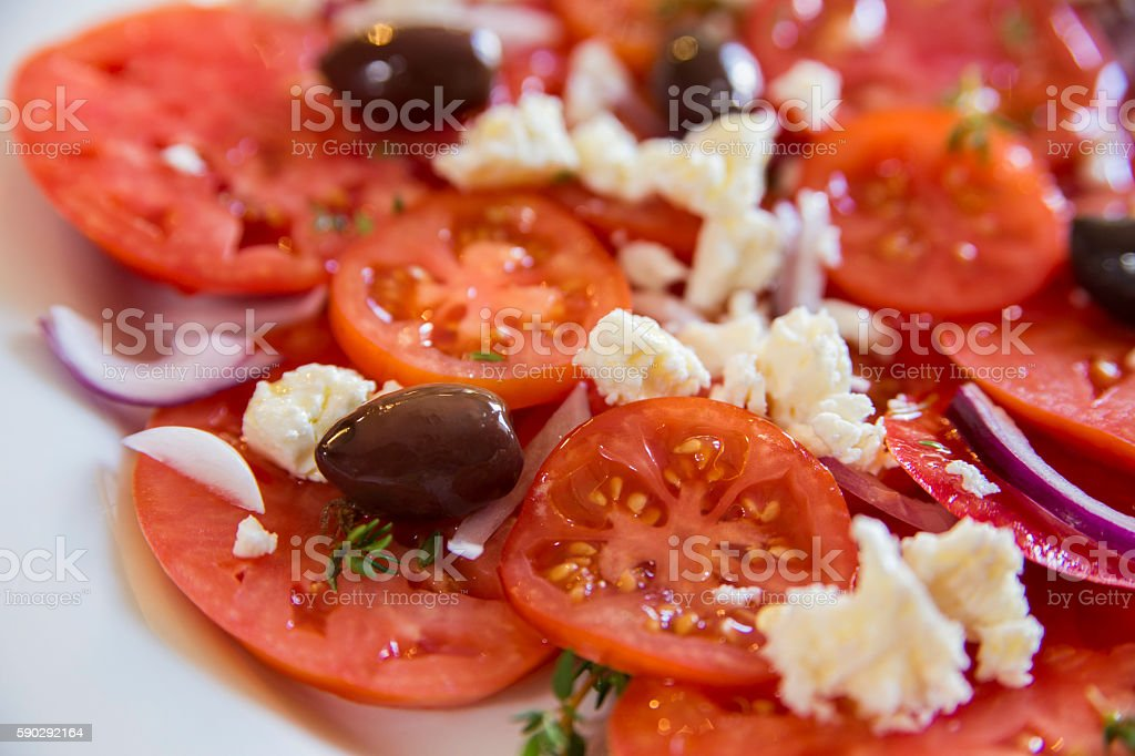 Tomatoes and feta salad Стоковые фото Стоковая фотография