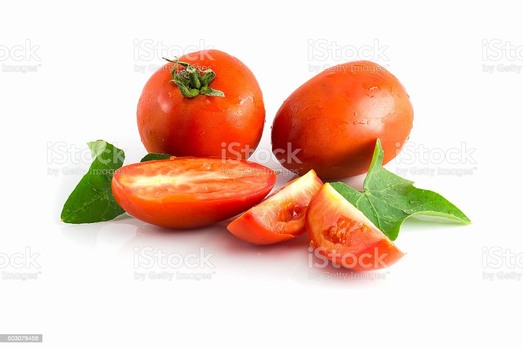 tomatoes and green leaves on white background stock photo