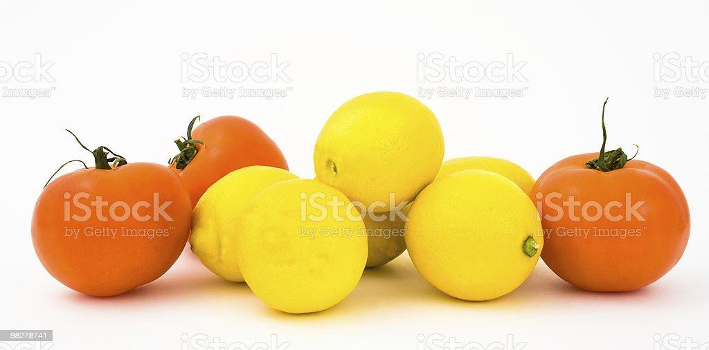 Tomatoes and lemons royalty-free stock photo