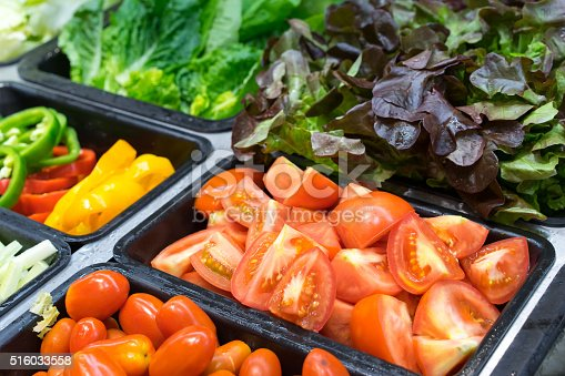 Tomatoes and other vegetables in salad trays