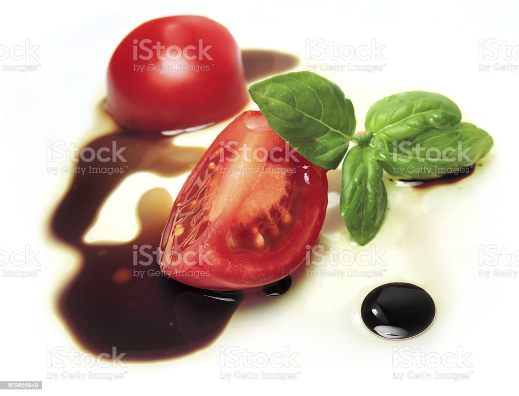 Tomatoes and salad dressing stock photo