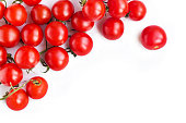 Top view of stack of tomatoes on white background.