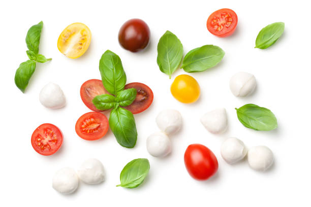 tomatoes, basil and mozzarella isolated on white background - mozzarella foto e immagini stock