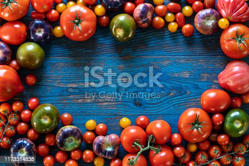 Tomatoes composition varied tomato on table wooden board
