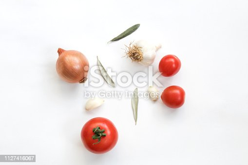 Tomatoes garlic and onion isolated on white background. Top view.