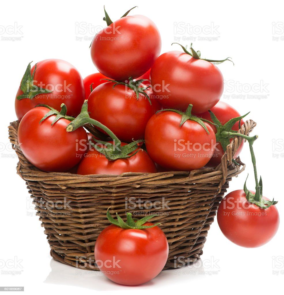 tomatoes in a woven basket stock photo