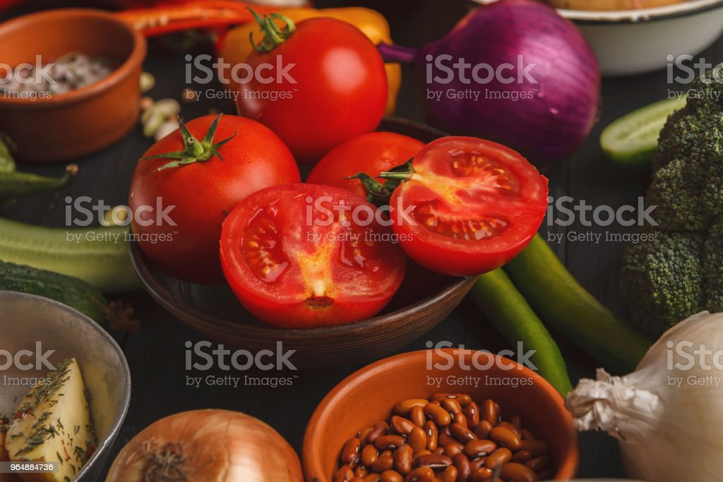 Tomatoes in bowl on wooden background royalty-free stock photo