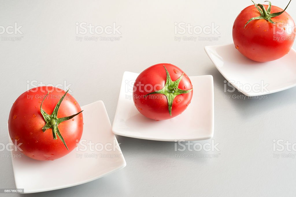 Tomatoes in individual japanese style dish stock photo