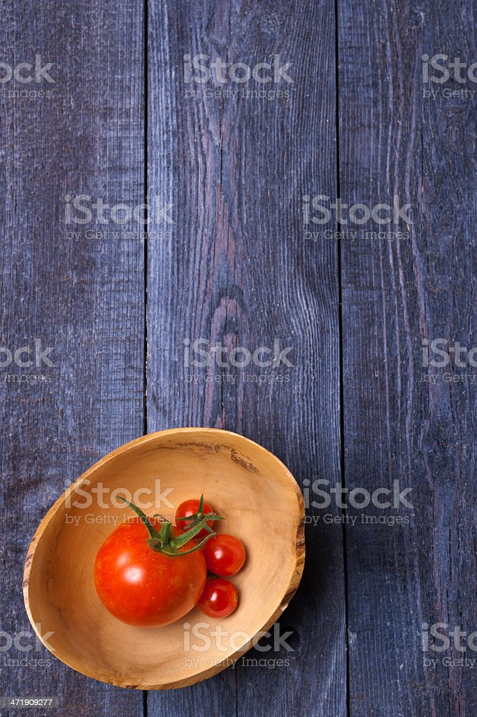 Tomatoes in Wooden Bowl royalty-free stock photo