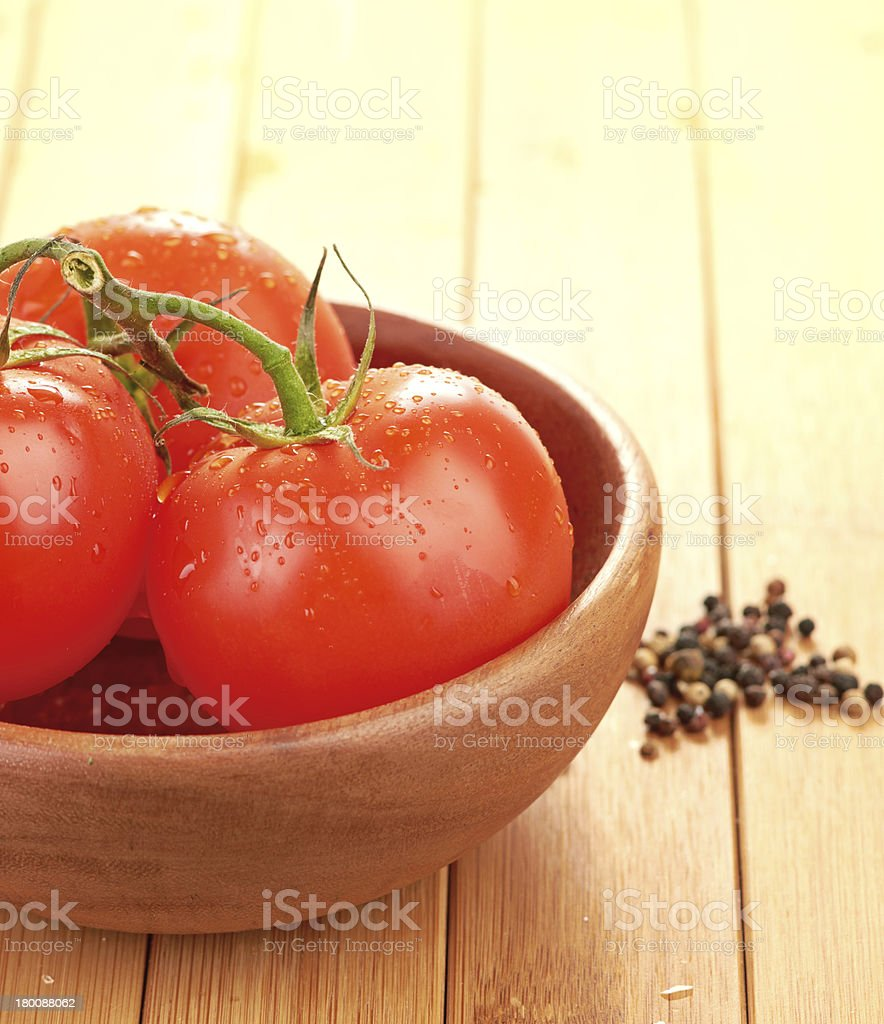 tomatoes in wooden bowlin royalty-free stock photo