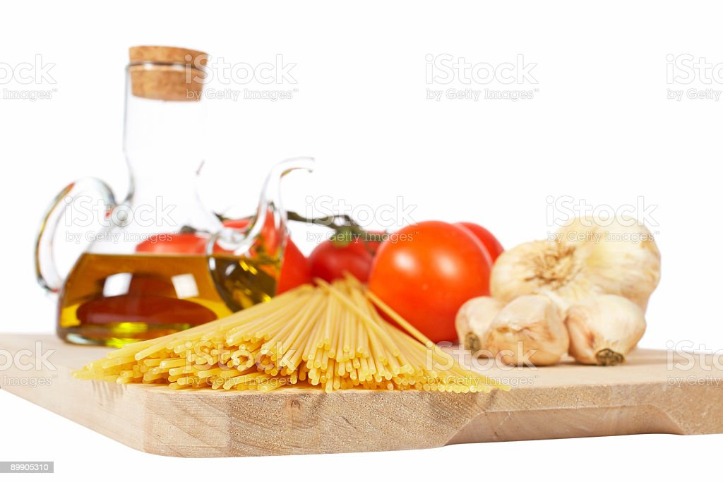 Tomatoes, olive oil, garlic and spaghetti royalty-free stock photo