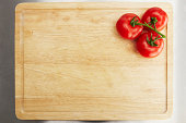 istock Tomatoes on a chopping board 174496369
