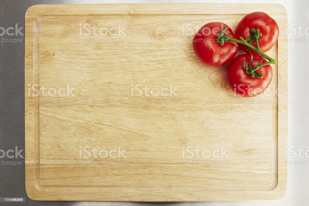 Tomatoes on a chopping board stock photo