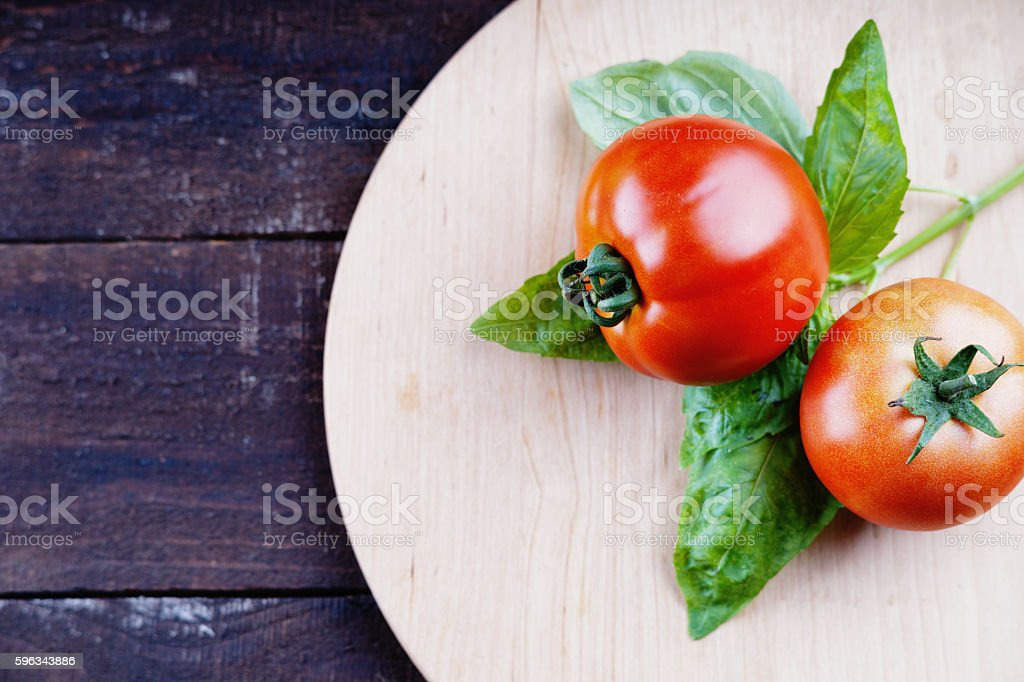 Tomatoes on a cutting board royalty-free stock photo