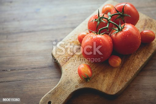 Tomatoes on a cutting board. Raw food.