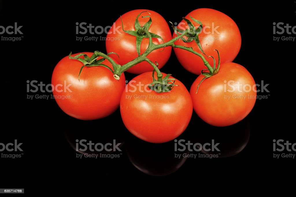 Tomatoes On Black royalty-free stock photo