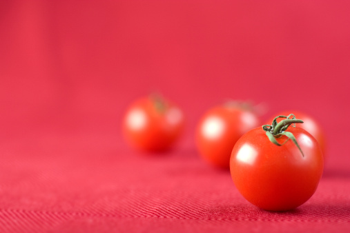 Tomatoes On Red Stock Photo - Download Image Now