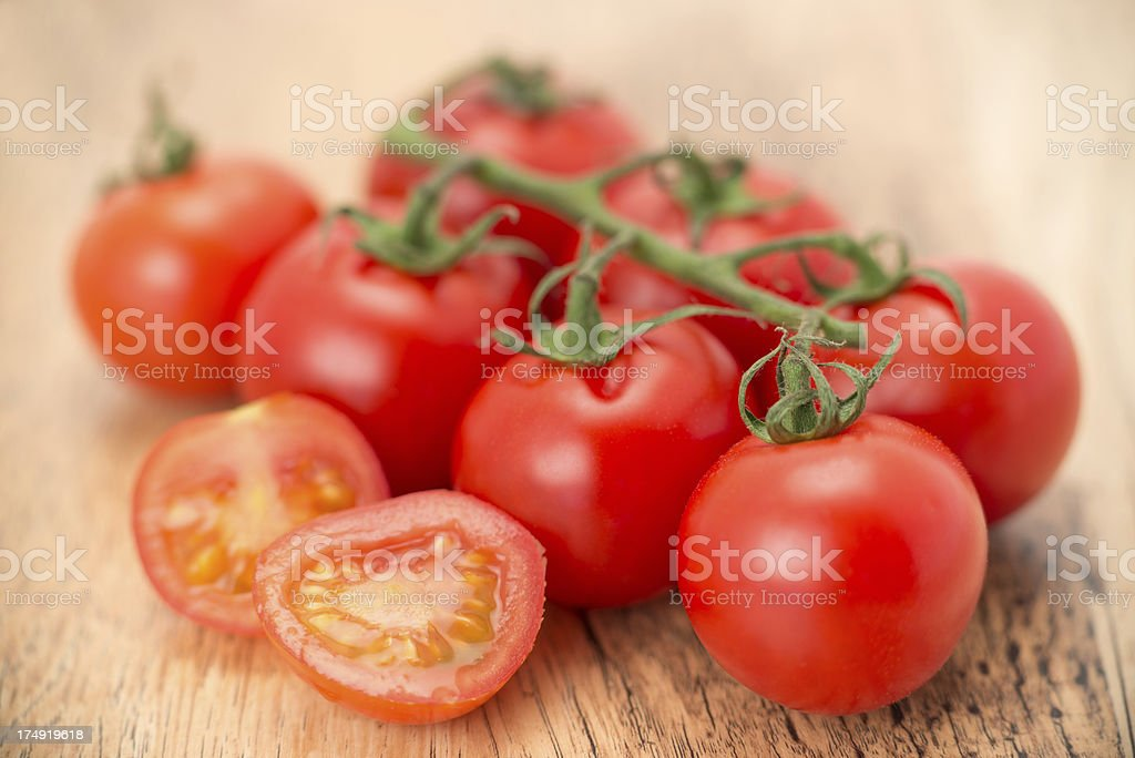 Tomatoes on the vine royalty-free stock photo