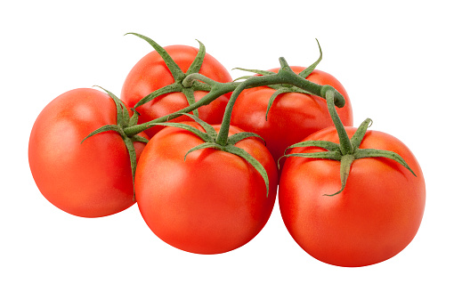 The tomato is in the basket
