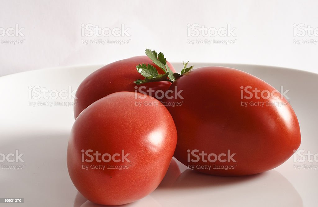 Tomatoes on White Plate royalty-free stock photo
