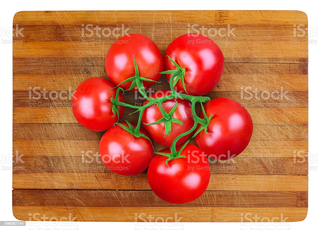tomatoes on wooden board royalty-free stock photo