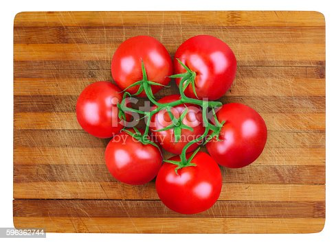 Tomatoes On Wooden Board Stock Photo & More Pictures of Bunch