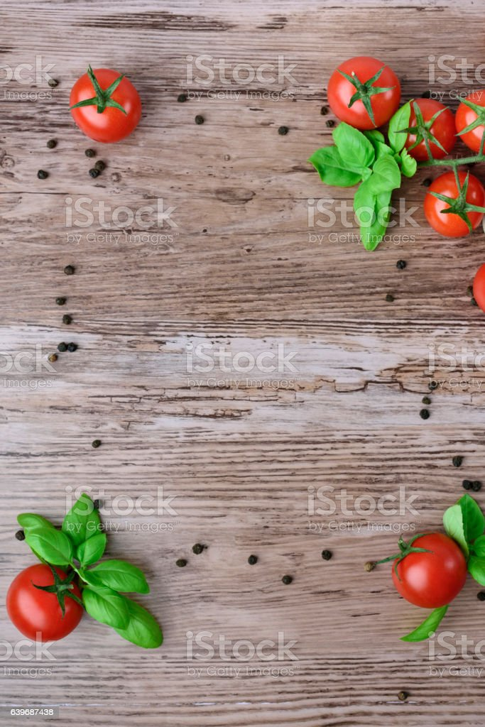 Tomatoes, pepper and the basil as a frame. – zdjęcie