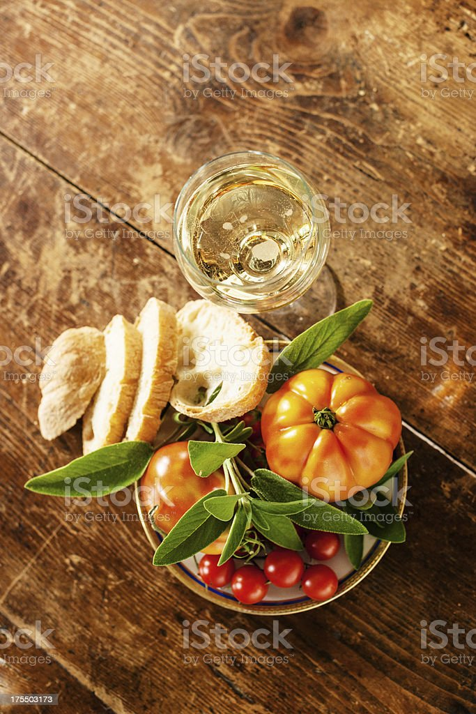 Tomatoes, sage and white sparkling wine royalty-free stock photo