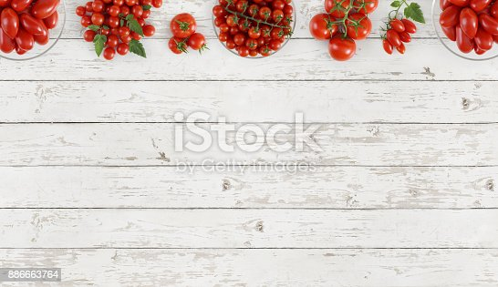 istock tomatoes top view on kitchen white wooden table copy space template 886663764