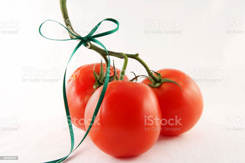 tomatoes with green ribbon royalty-free stock photo