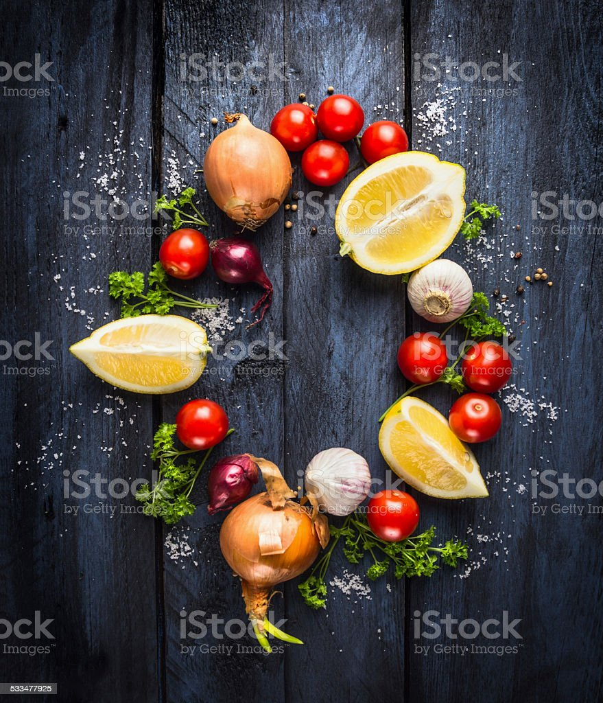 Tomatoes with herbs and spices, ingredient for tomato sauce stock photo