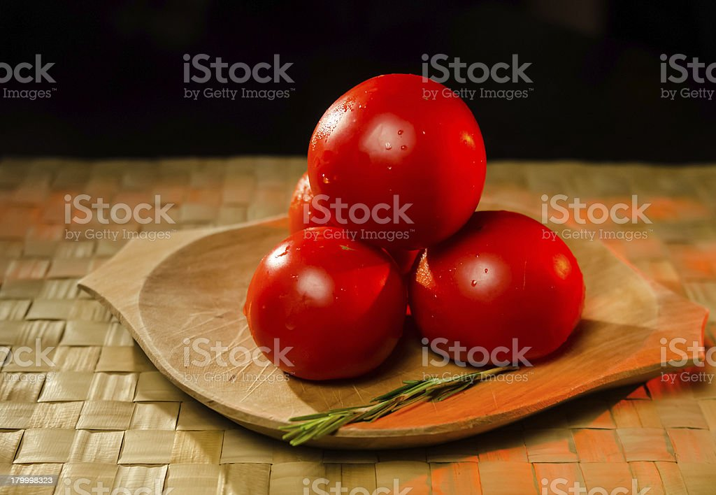 Tomatoes with rosemary royalty-free stock photo