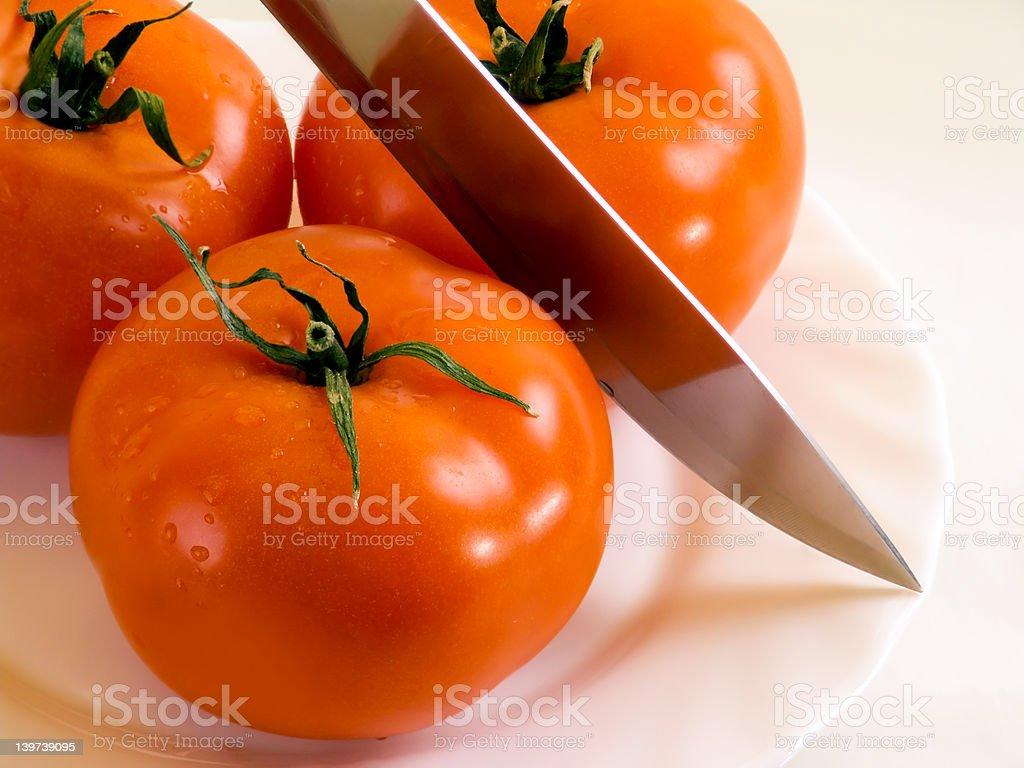 Tomatos and knife royalty-free stock photo