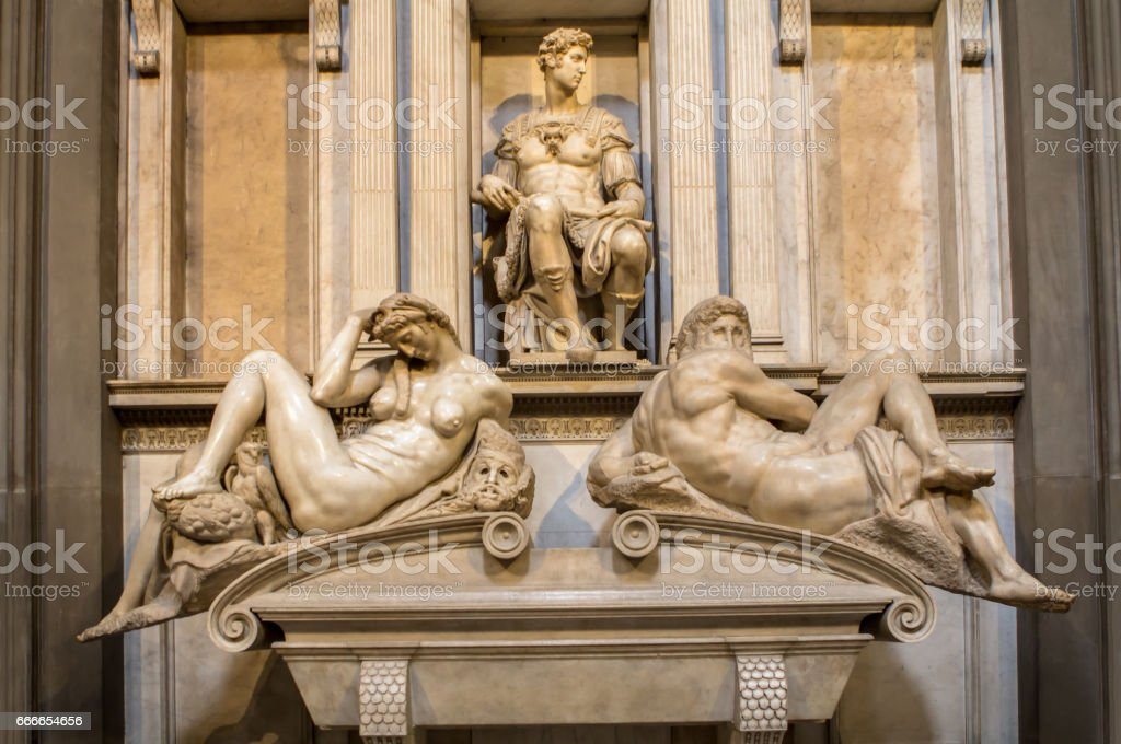 Tomb of Giuliano de Medici and sculptures 'Night and Day' stock photo