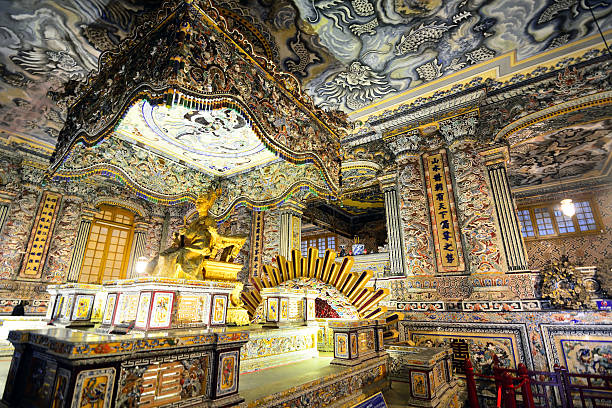 Tomb of Khai Dinh The Tomb, was built from 1920 to 1931, of Khai Dinh is located in Chau Chu mountain near Hue in Vietnam khai dinh tomb stock pictures, royalty-free photos & images