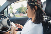 istock Tomboy Chinese woman driver checking destination directions on the mobile app 1275791211