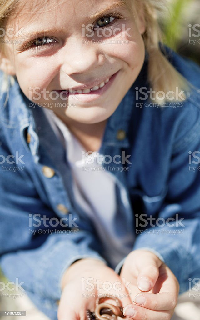 Tomboy holding a worm stock photo