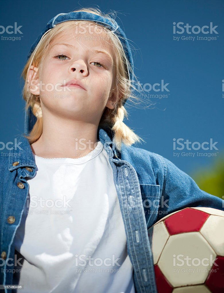 Tomboy playing soccer stock photo