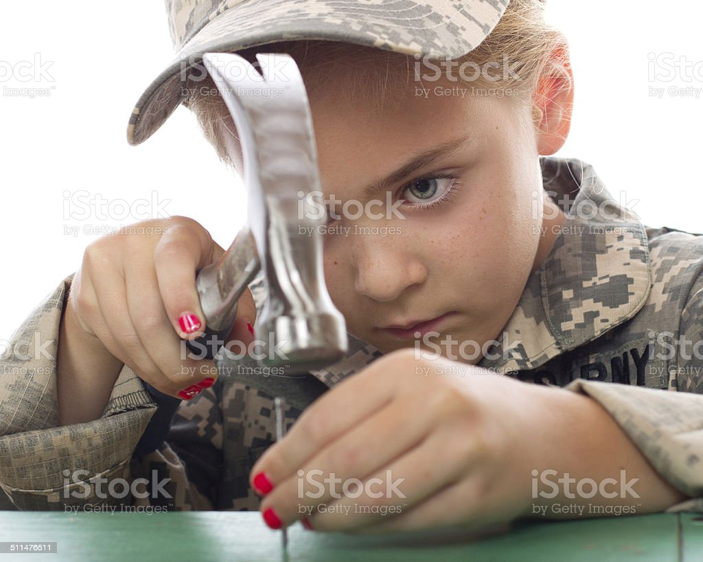 Tomboy with hammer stock photo