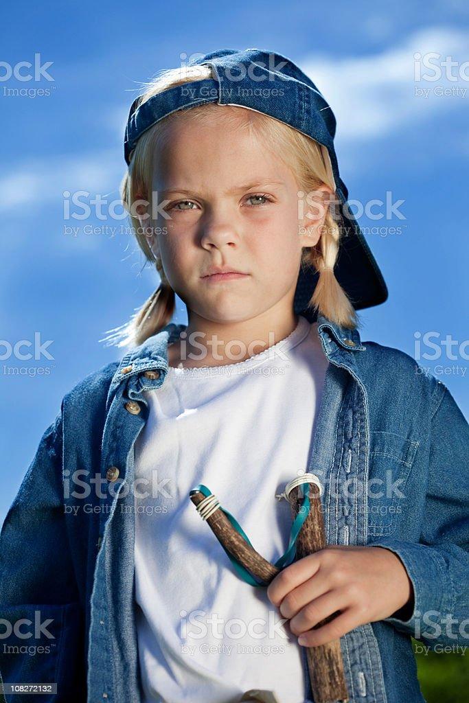 Tomboy with slingshot stock photo