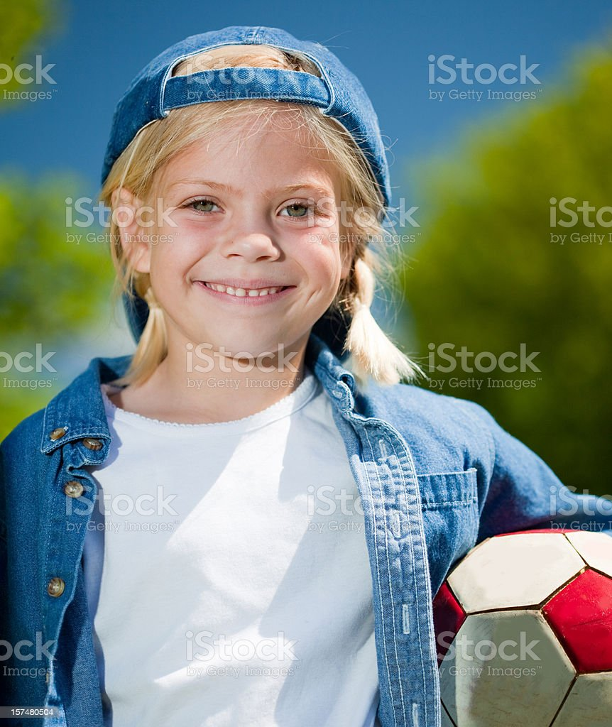 Tomboy with soccer ball stock photo