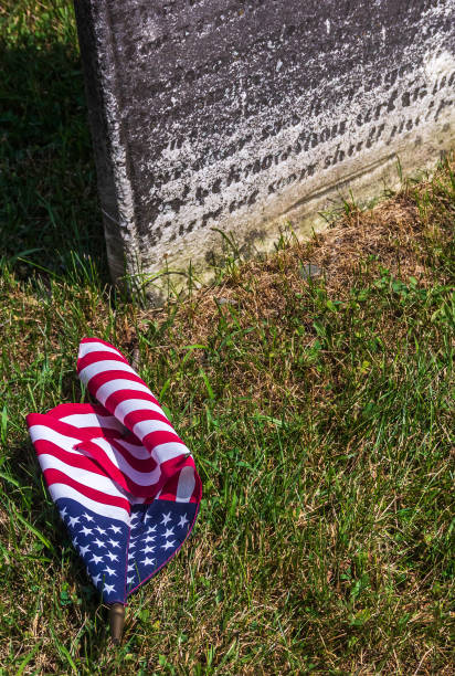 Tombstone and flag stock photo
