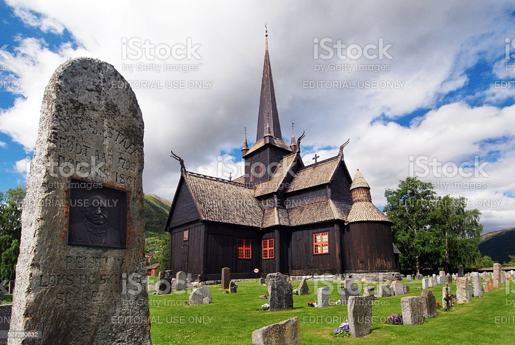 Tombstone and wooden church of Lom, Norway stock photo