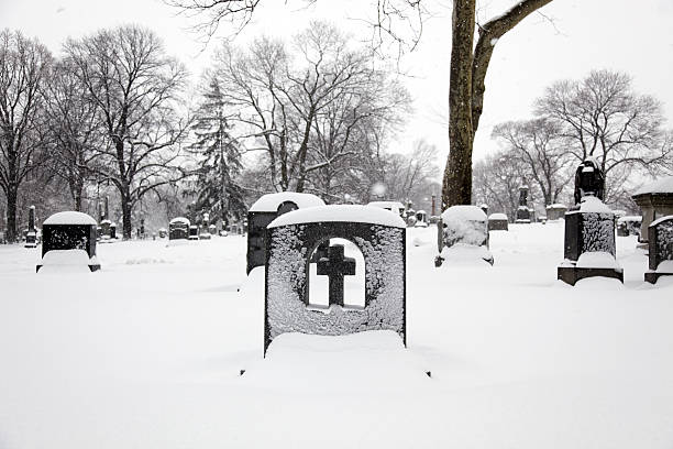 Tombstone in the snow stock photo