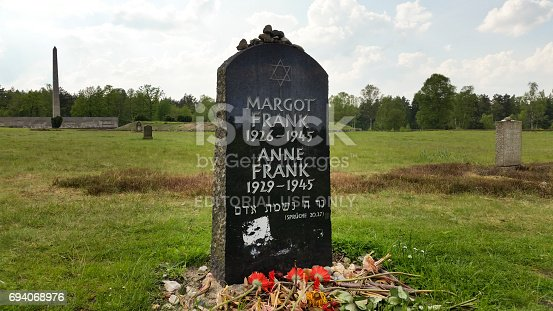 Bergen-Belsen, Germany - May 20, 2017:  Lohheide symbolic gravestone memorial of Anne and Margot Frank at the former Bergen-Belsen concentration camp in Germany.