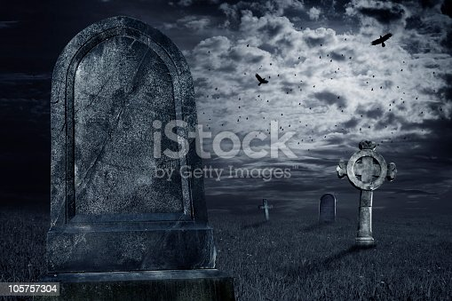 Old tombstone with a dark sky. Add your text. Halloween theme.