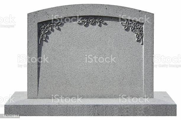 isolated granite tombstone with flowers