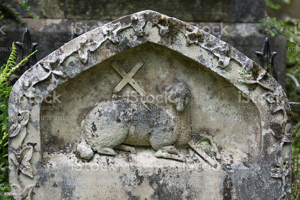 Tombstone with Agnus Dei, Lamb of God. stock photo